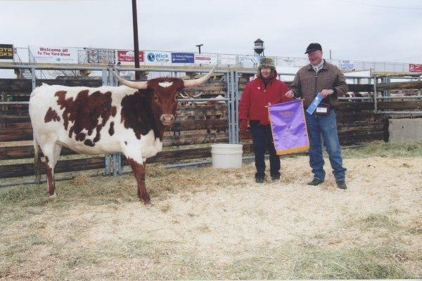 Lucy, with Marsha and Randy, after winning her first of two Grand Champion Cow awards at Denver's National Western Stock Show in 2010_Scan7_0007_0001